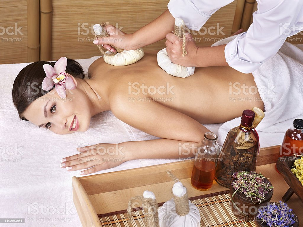Young woman on massage table in beauty spa. Series. stock photo
