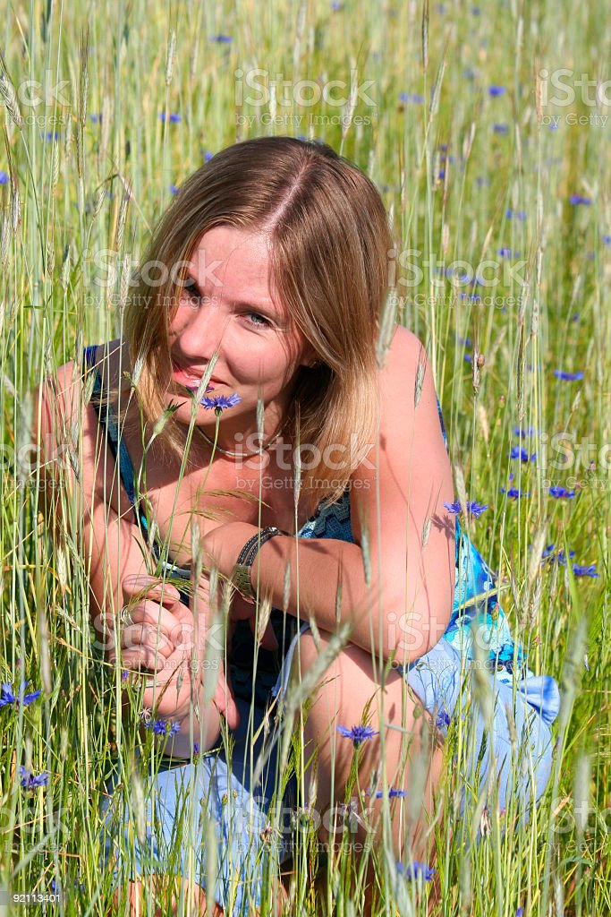 young woman on meadow royalty-free stock photo