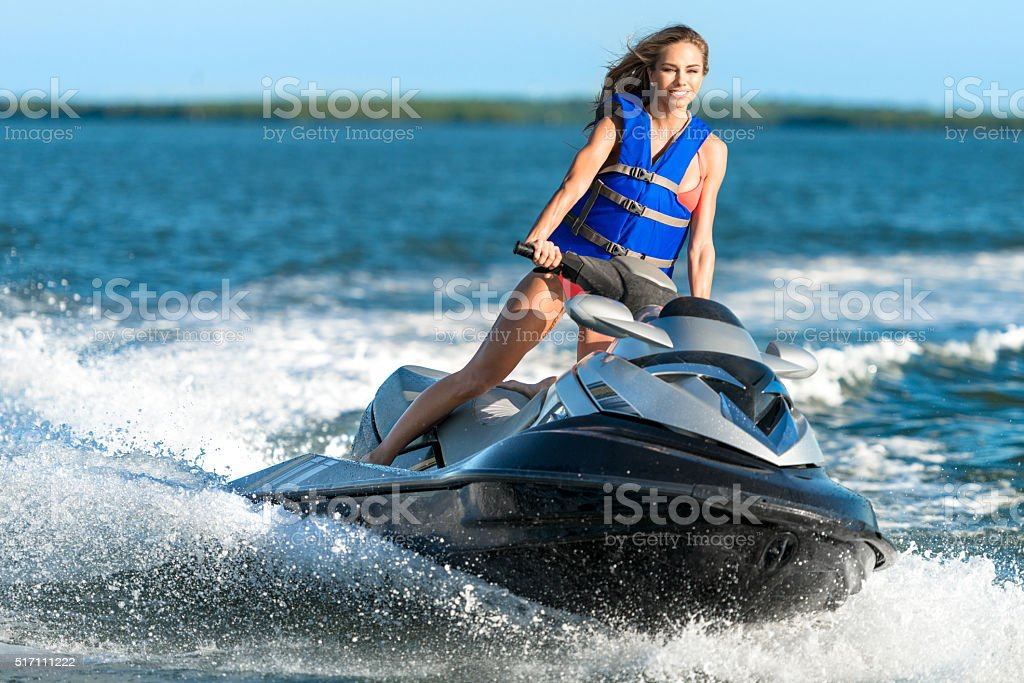 Young Woman on Personal Water Craft stock photo
