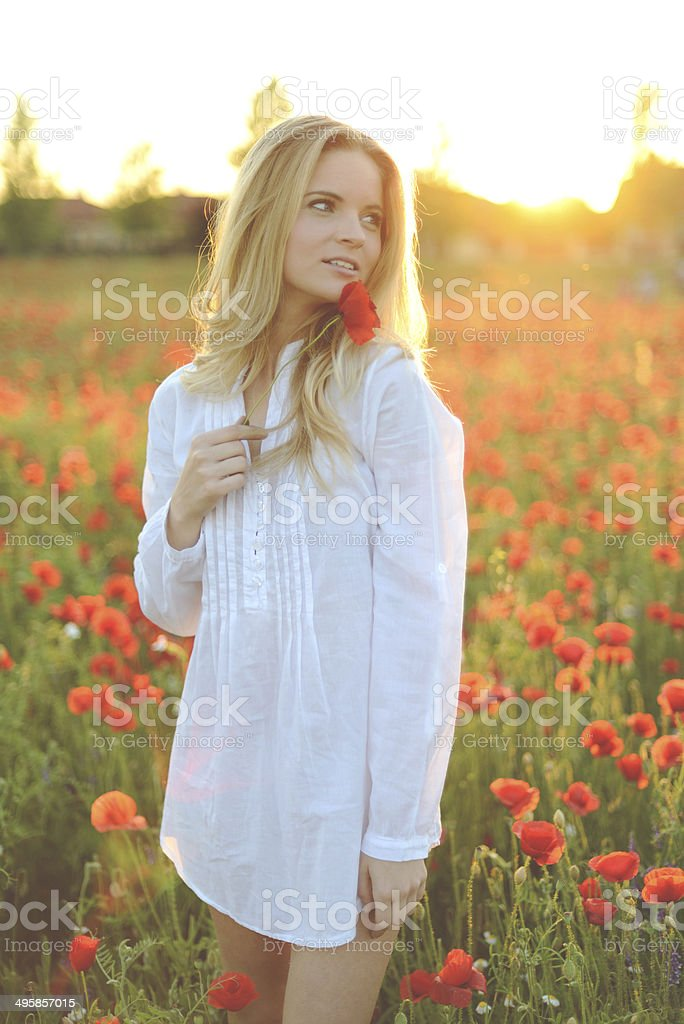 Young woman on poppy field royalty-free stock photo