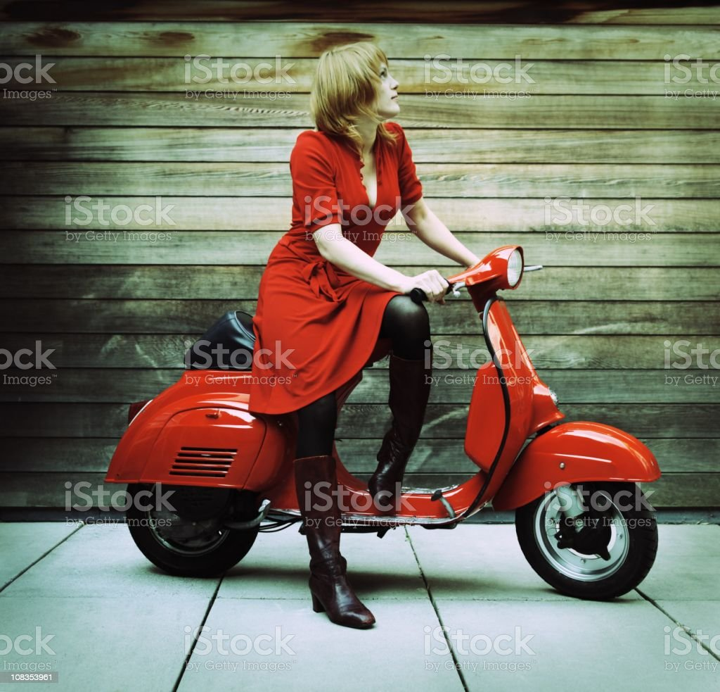 Young Woman on Red Vintage Retro Scooter royalty-free stock photo