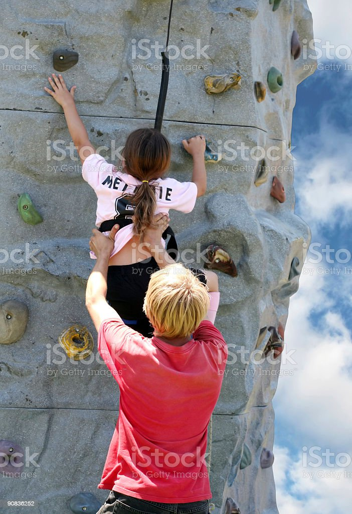 Young woman on rock wall royalty-free stock photo