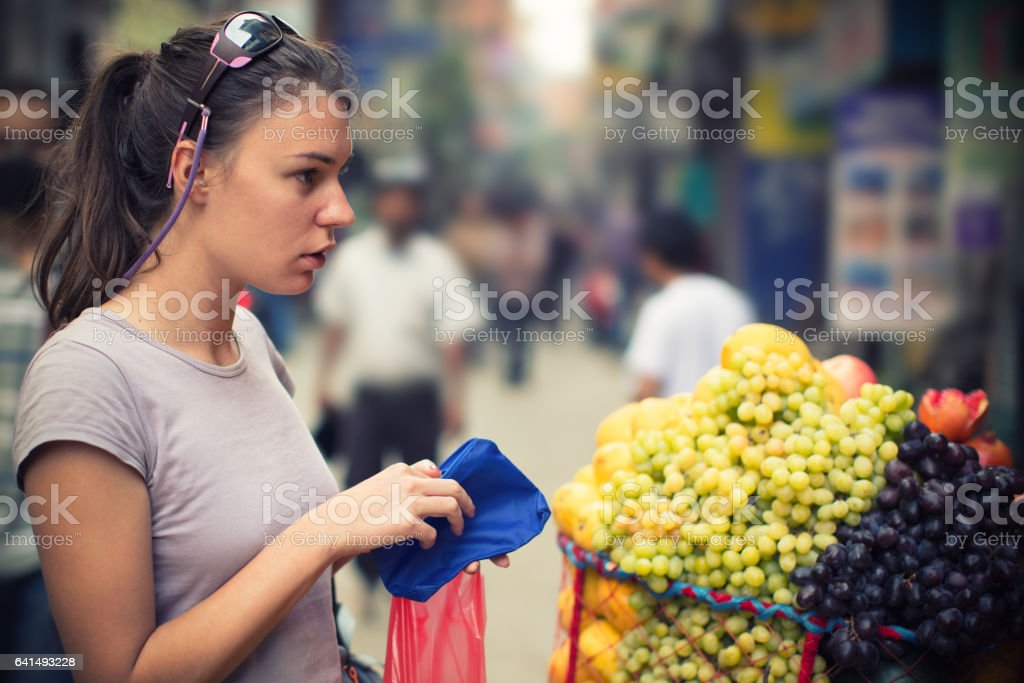 Young woman on street market shopping stock photo