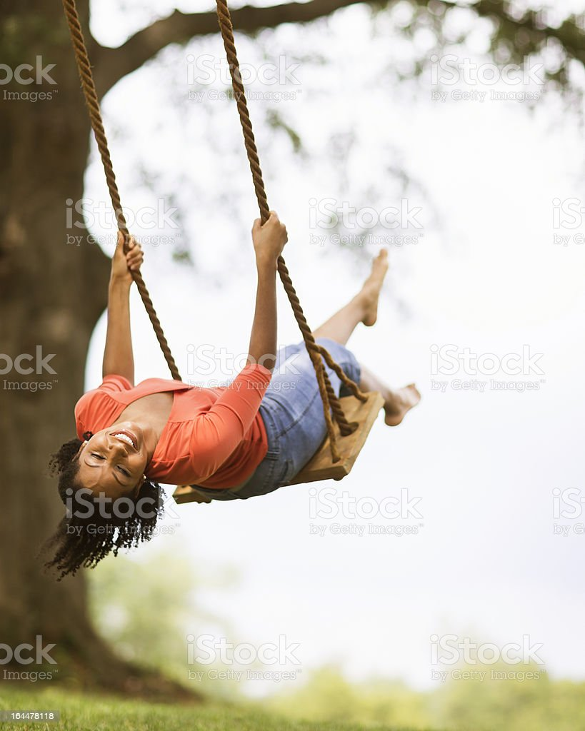 Young Woman on Swing stock photo