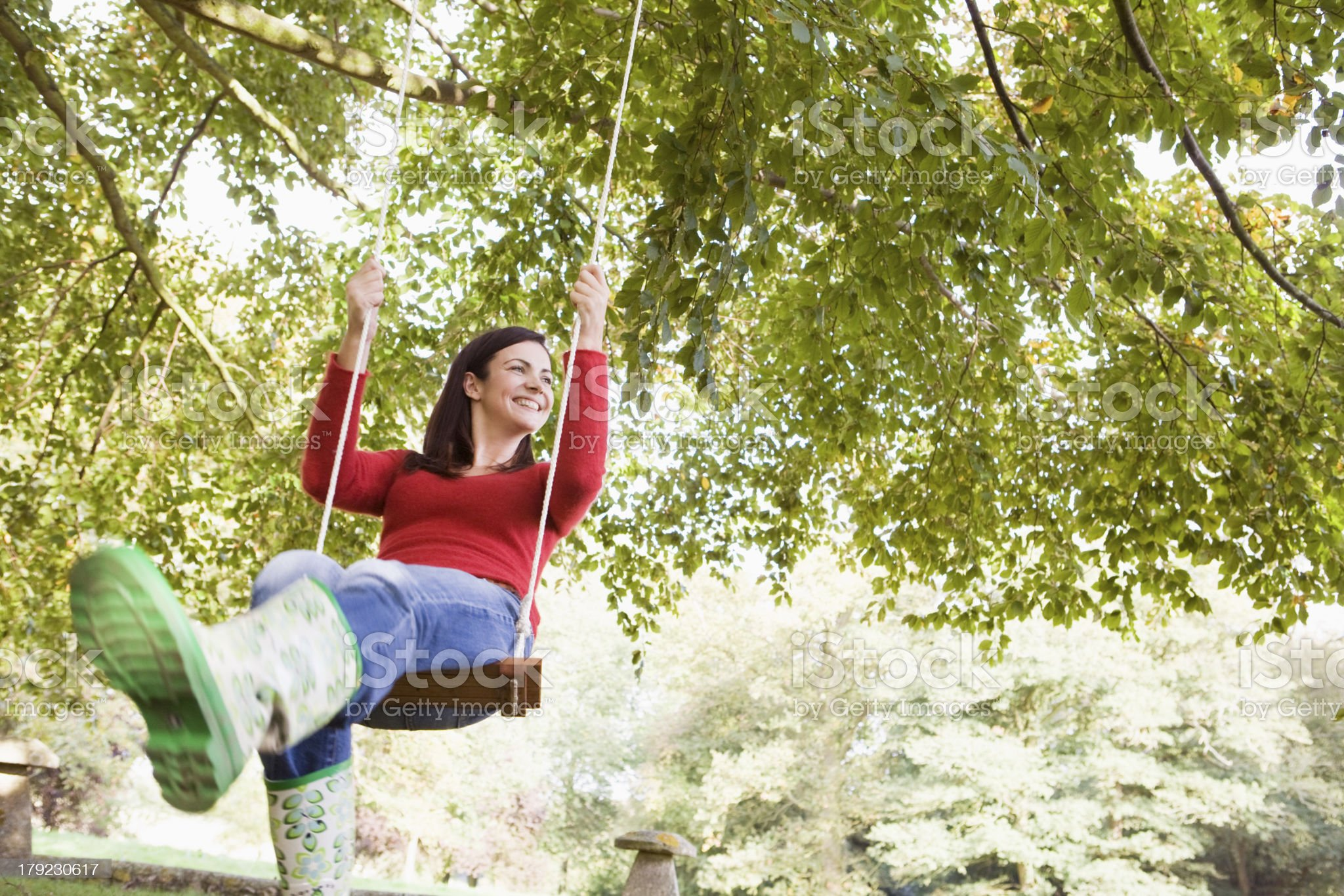 Young woman on swing royalty-free stock photo
