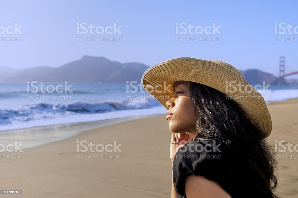 Young Woman on the Beach Wearing Hat royalty-free stock photo