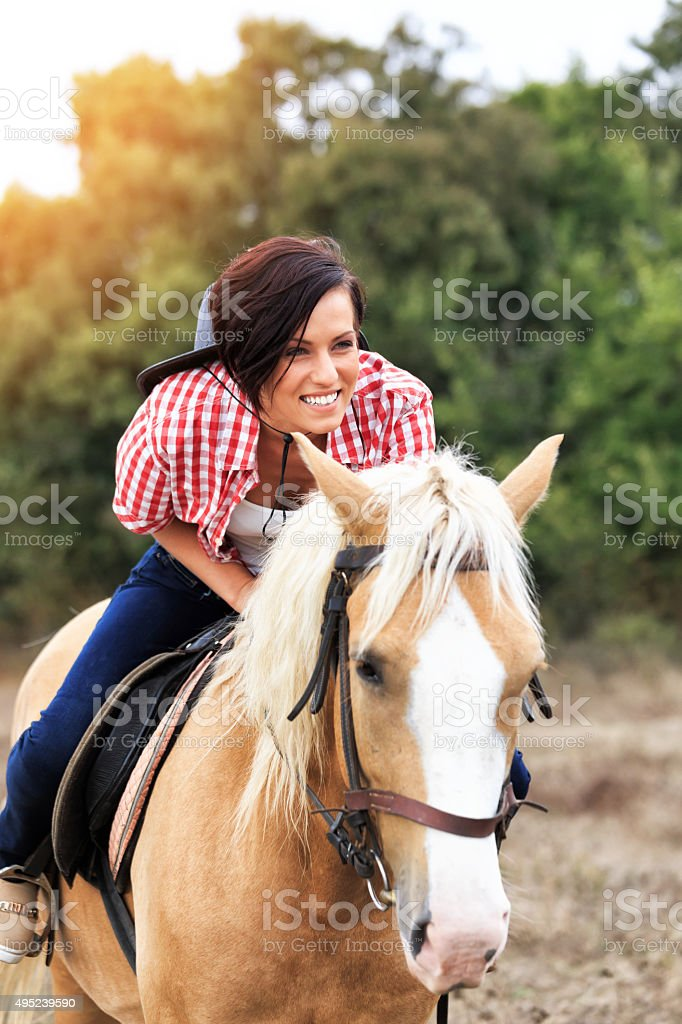 Young woman on the horse stock photo