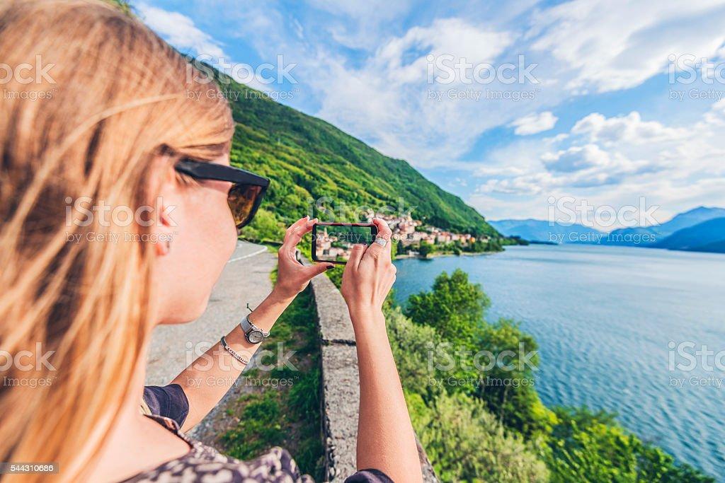 Young woman on the Lake Como, Italy stock photo