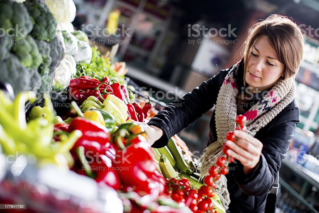 Young woman on the market royalty-free stock photo