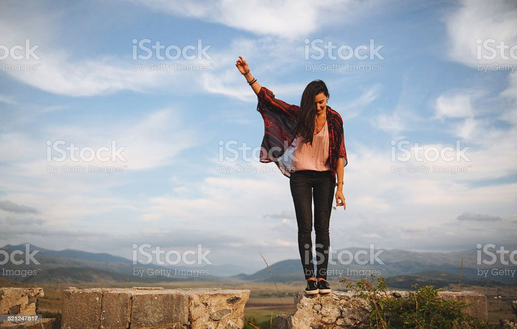 Young woman on the peak of a mountain range stock photo