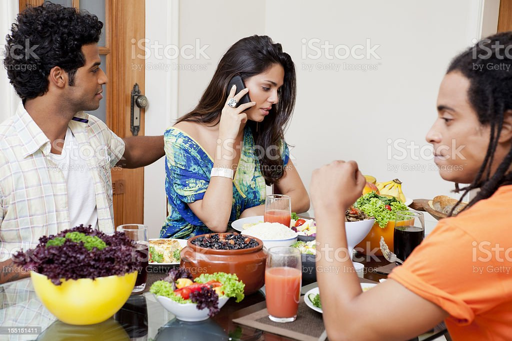 Young woman on the phone at lunch table royalty-free stock photo