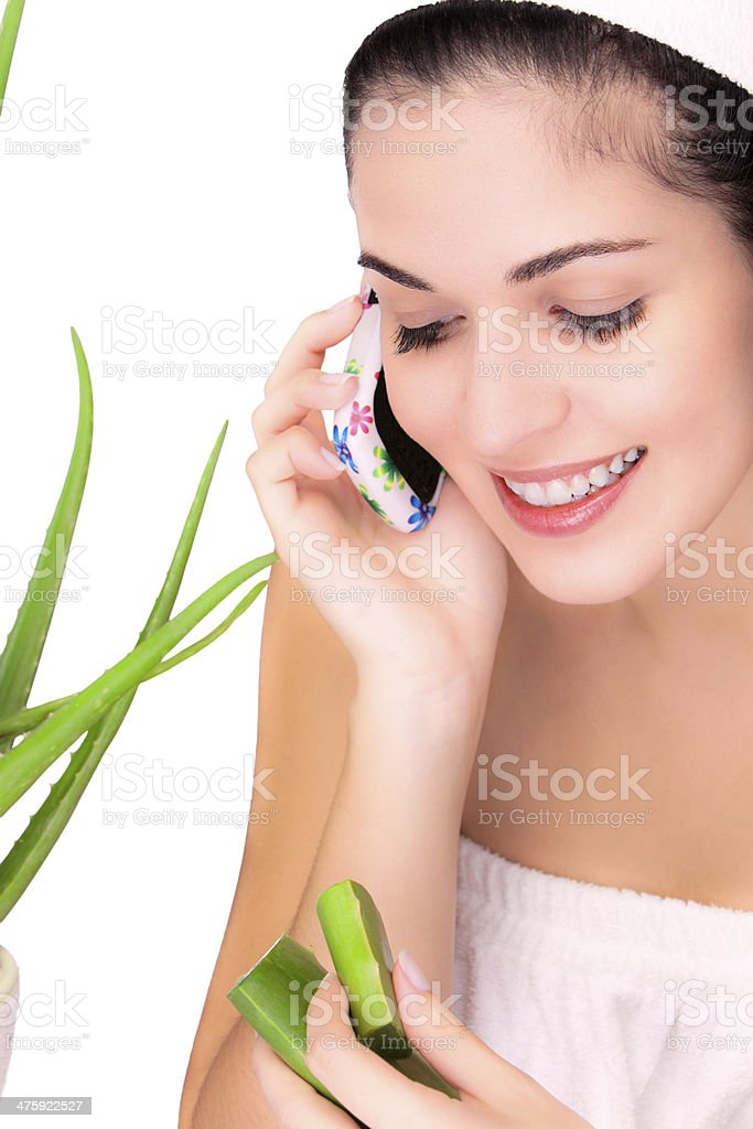Young woman on the phone ready to apply aloe vera royalty-free stock photo