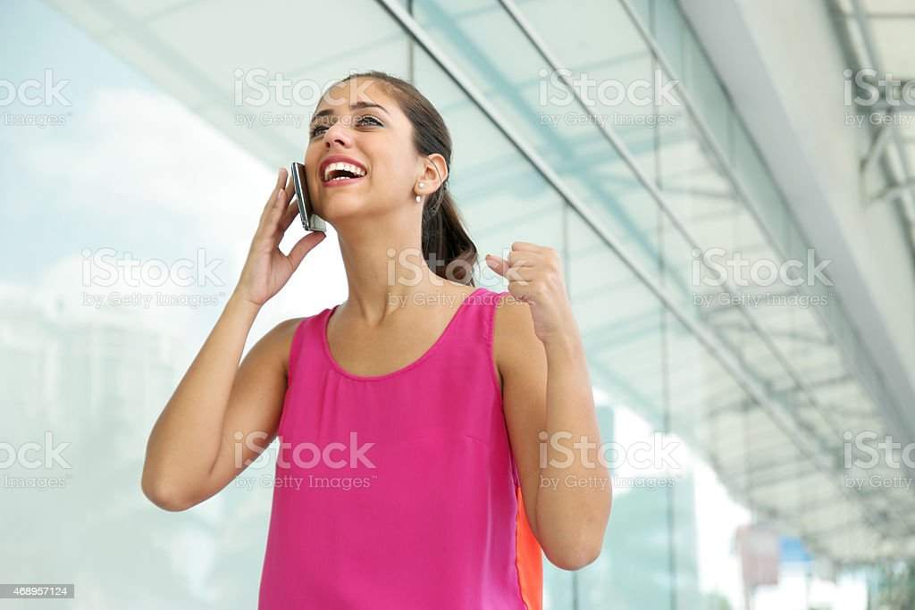 Young Woman On The Phone Smiling For Joy stock photo