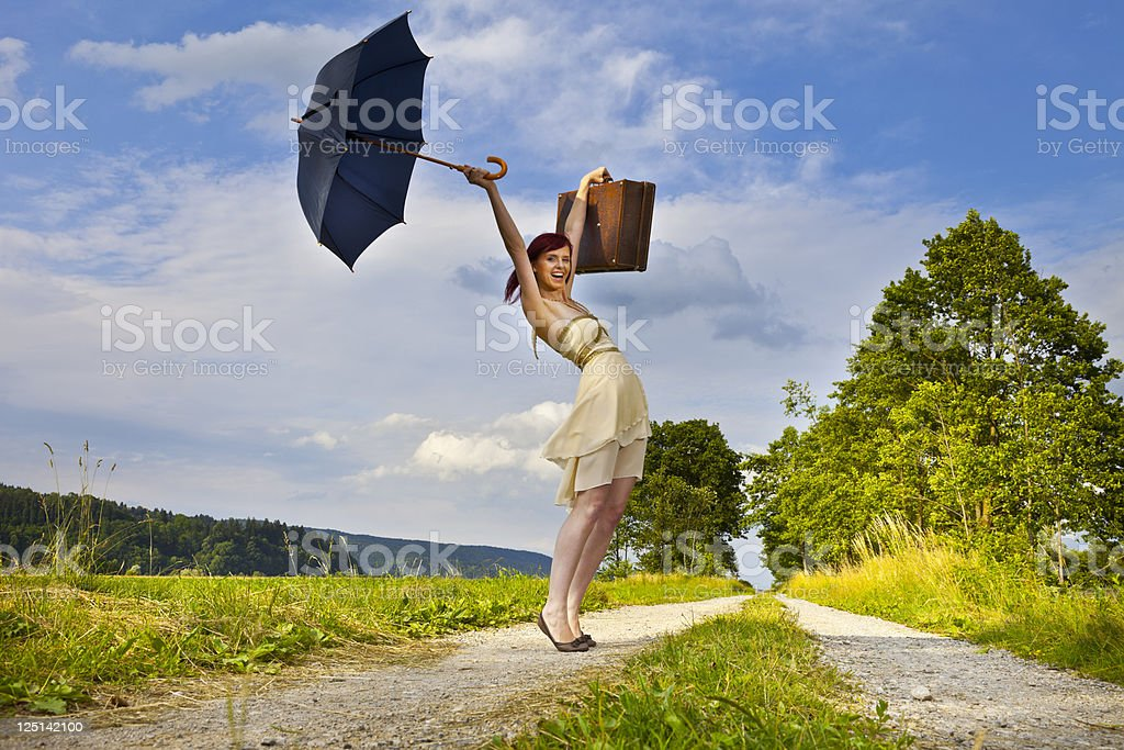 Young woman on the road stock photo