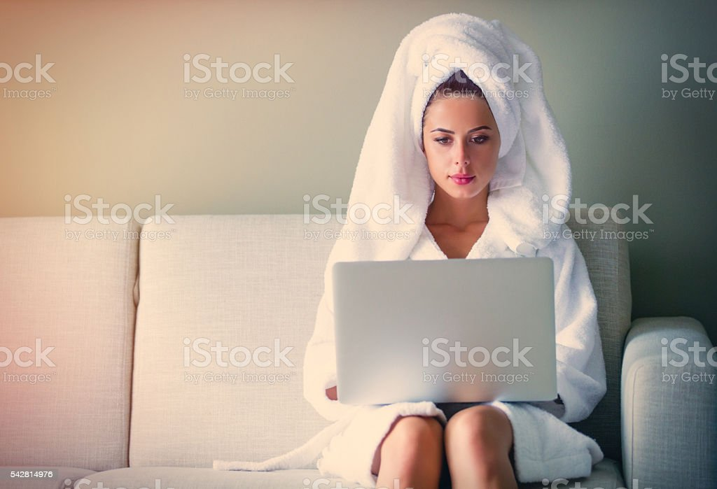 young woman on the sofa stock photo