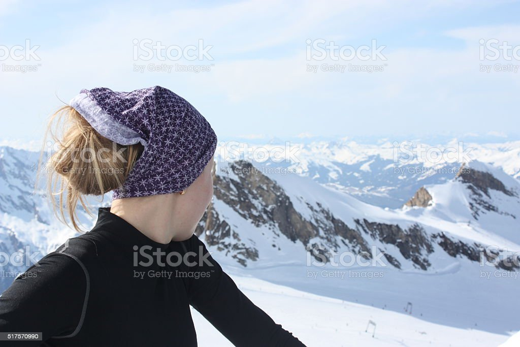 Young woman on the top of the mountain. stock photo