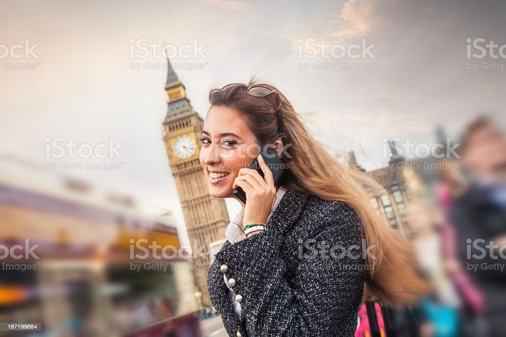 Young woman on the Westminster Bridge royalty-free stock photo
