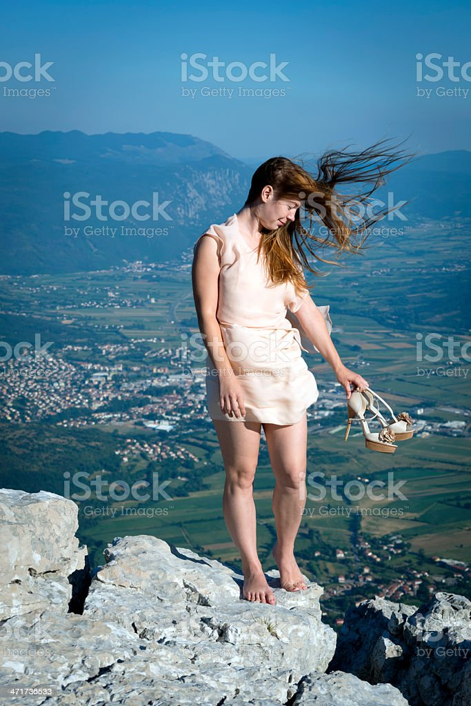Young Woman on Top of Mountains Alps Slovenia stock photo