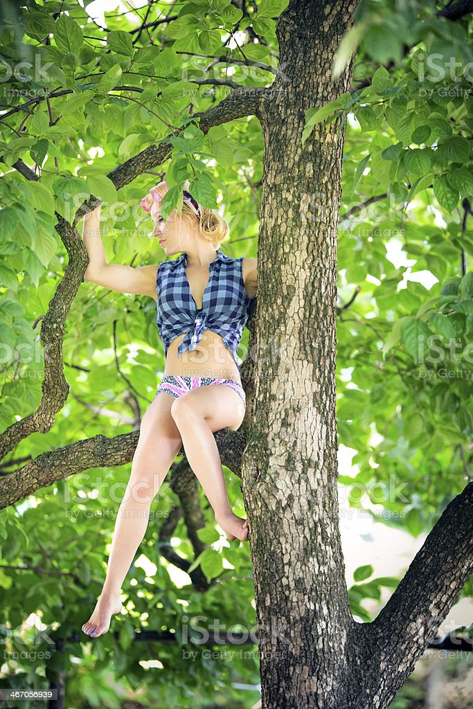 Young woman on tree royalty-free stock photo