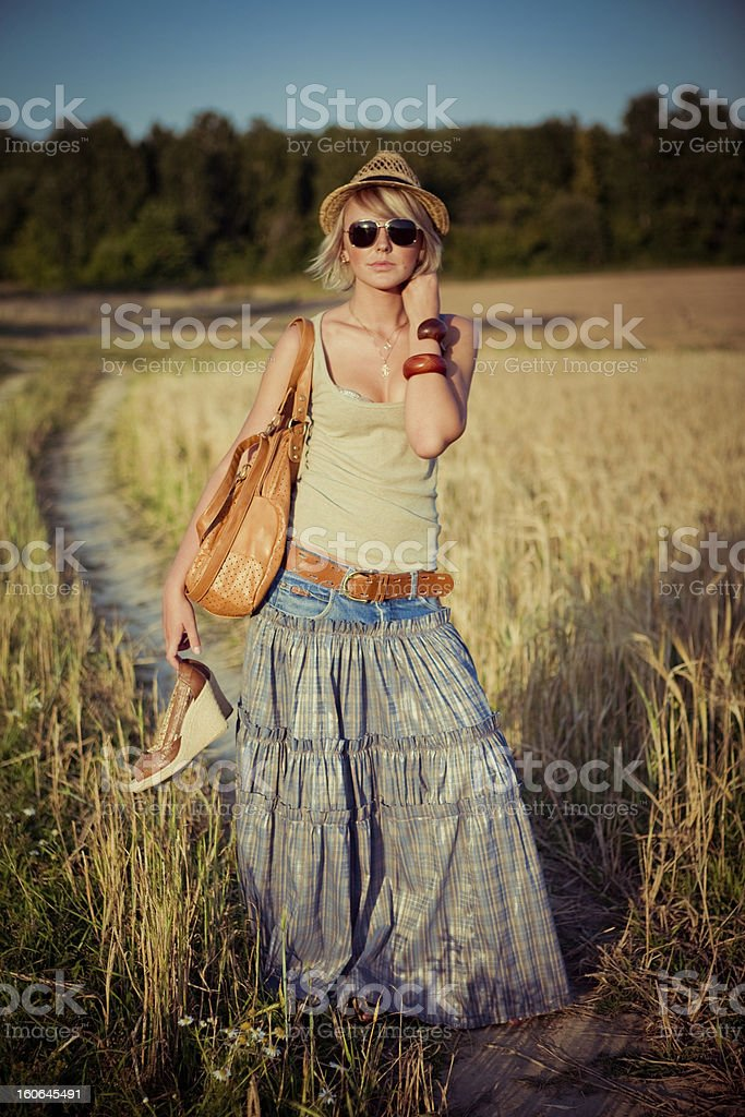 young woman on wheat field royalty-free stock photo