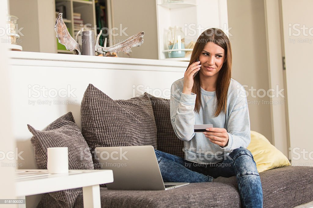 Young woman online shopping from home stock photo