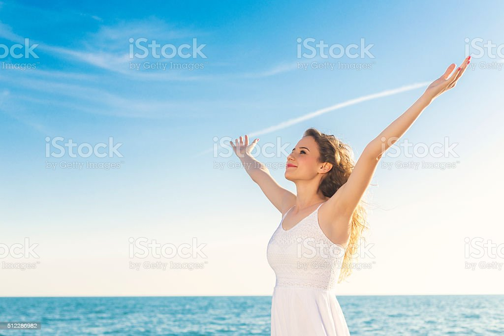 Young woman open arms stock photo