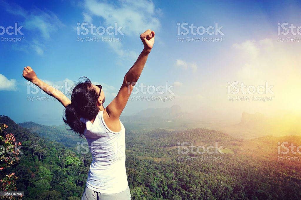 young woman open arms seaside stock photo