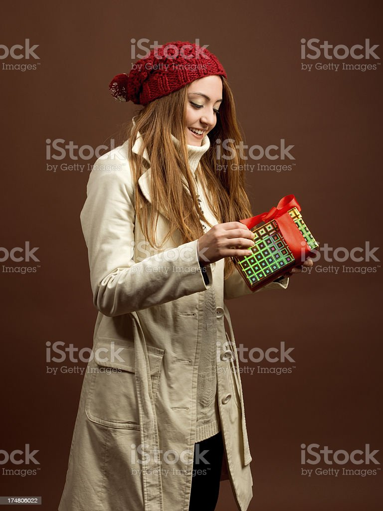 Young woman opening Christmas gift box royalty-free stock photo