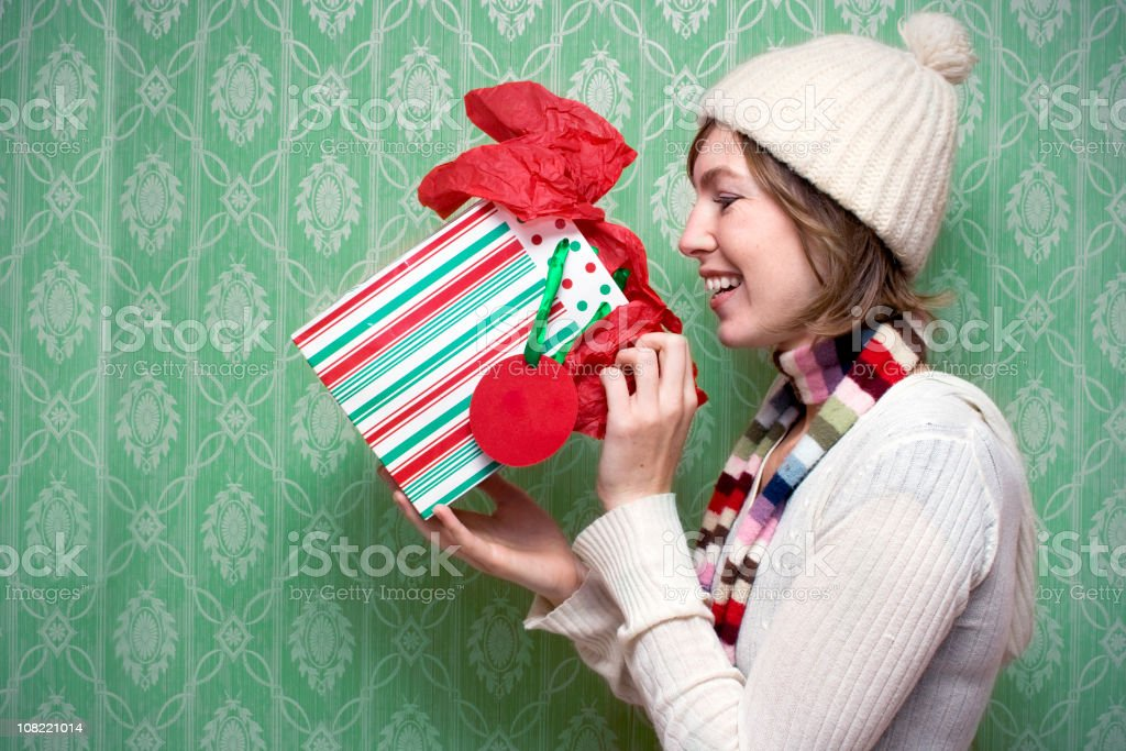 Young woman opening her present at holidays royalty-free stock photo