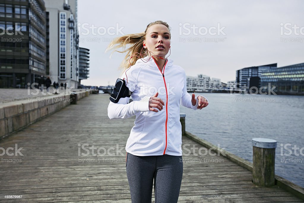 Young woman out for a jog stock photo