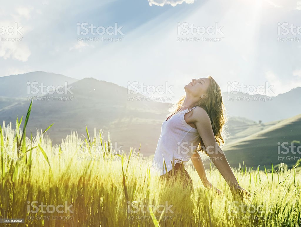 Young woman outdoor enjoying the sunlight stock photo