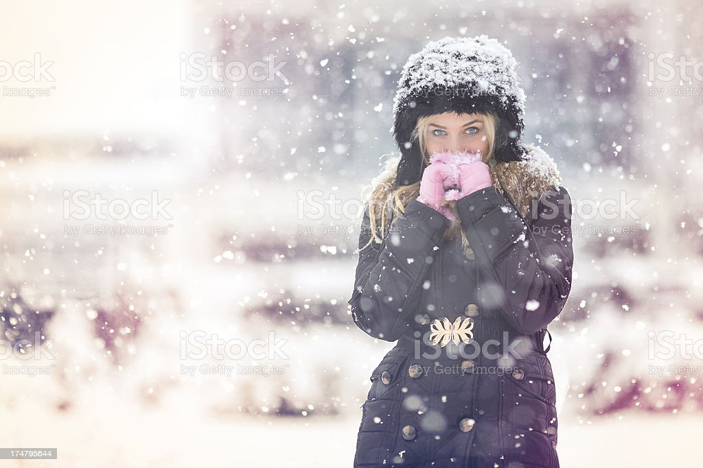 Young woman outdoor on a winter snowing day royalty-free stock photo