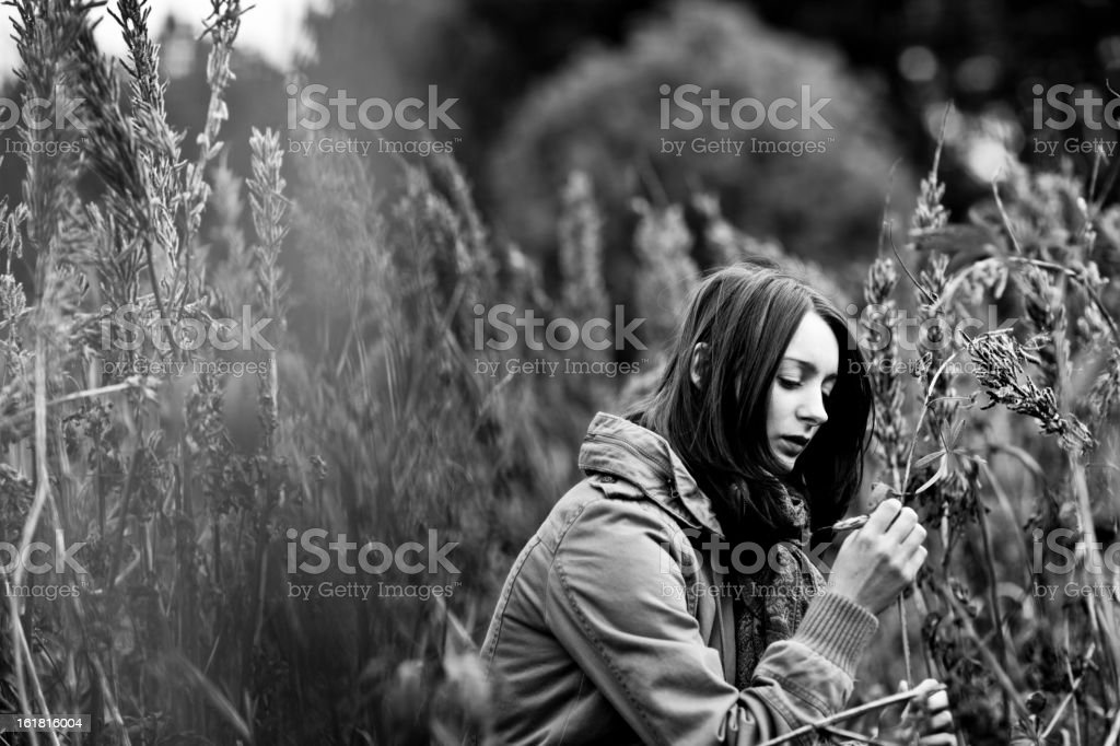 young woman outdoor, playfull in the grass royalty-free stock photo