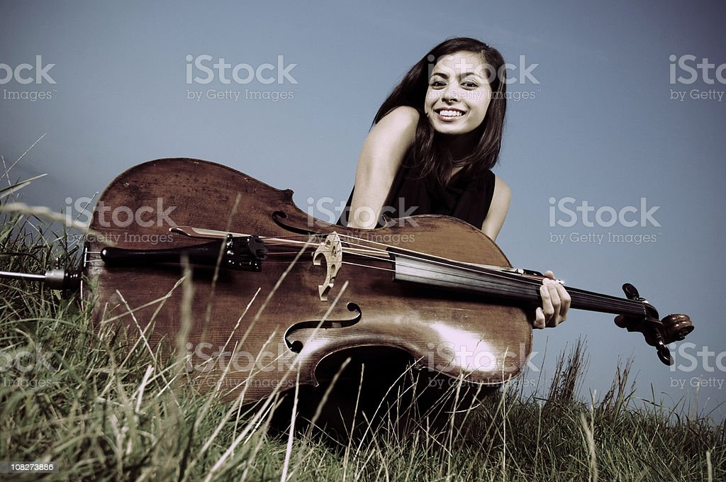 Young woman outdoor with cello royalty-free stock photo
