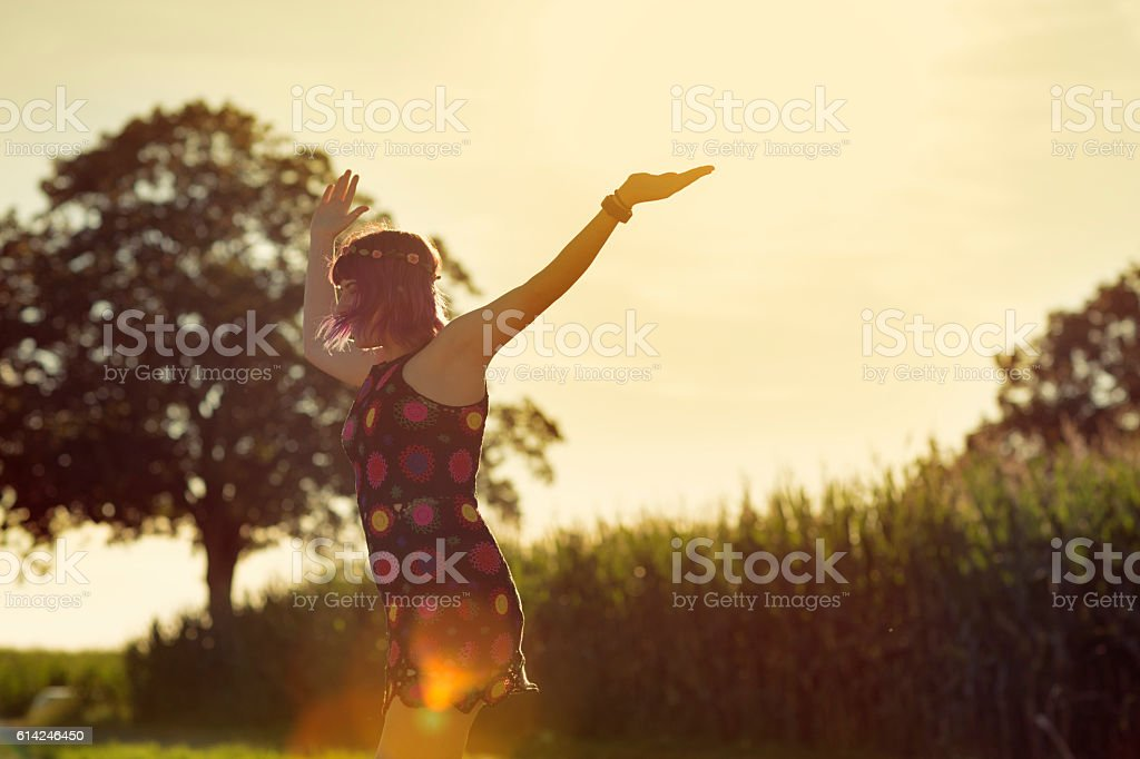 Young woman outdoors in summer happiness stock photo
