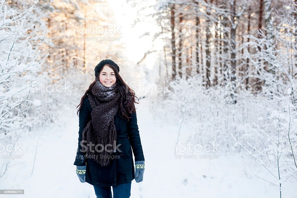Young woman outdoors in winter snow stock photo