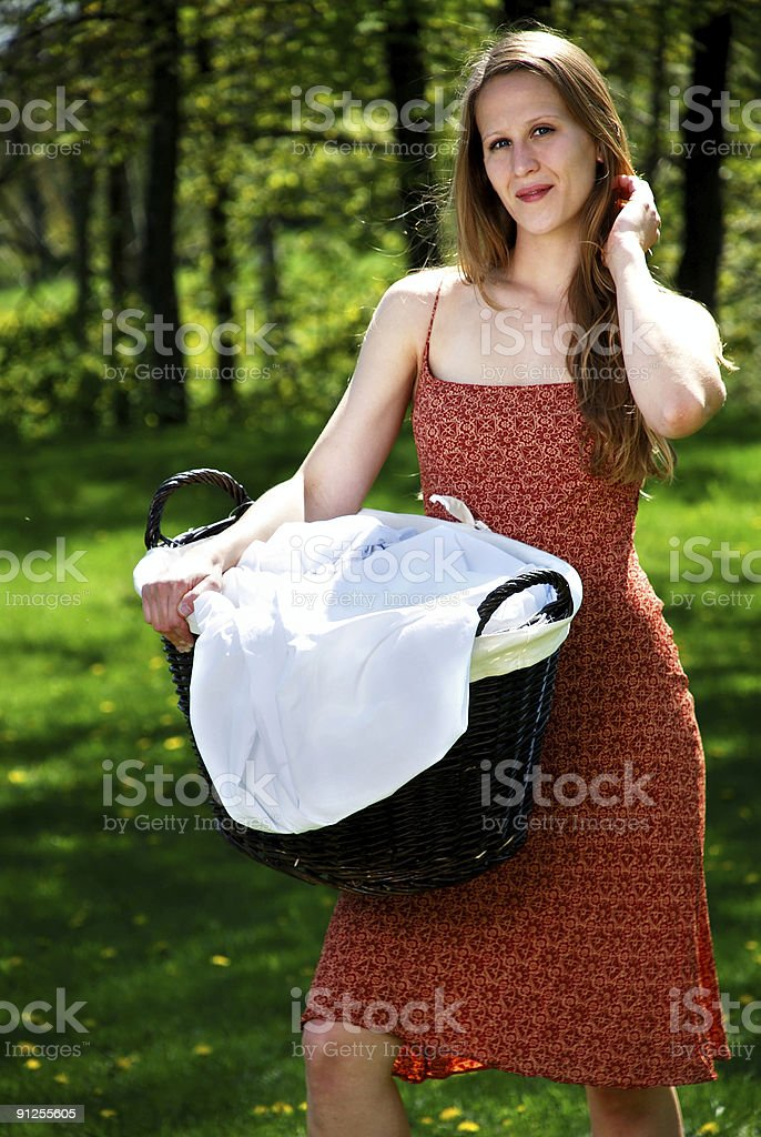 young woman outdoors with a basket of laundry