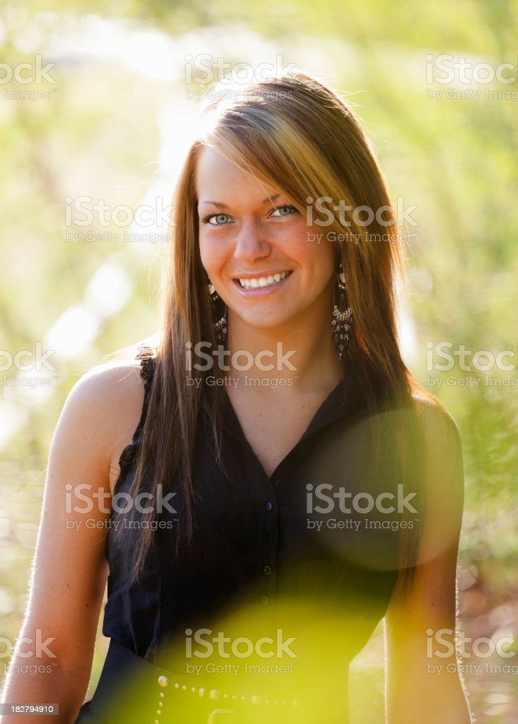 Young Woman Outdoors with Lens Flare stock photo