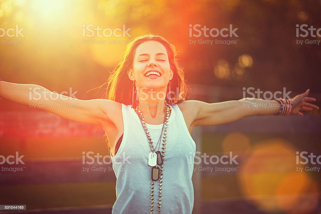 Young woman outstretched arms enjoys the freedom and fresh air stock photo