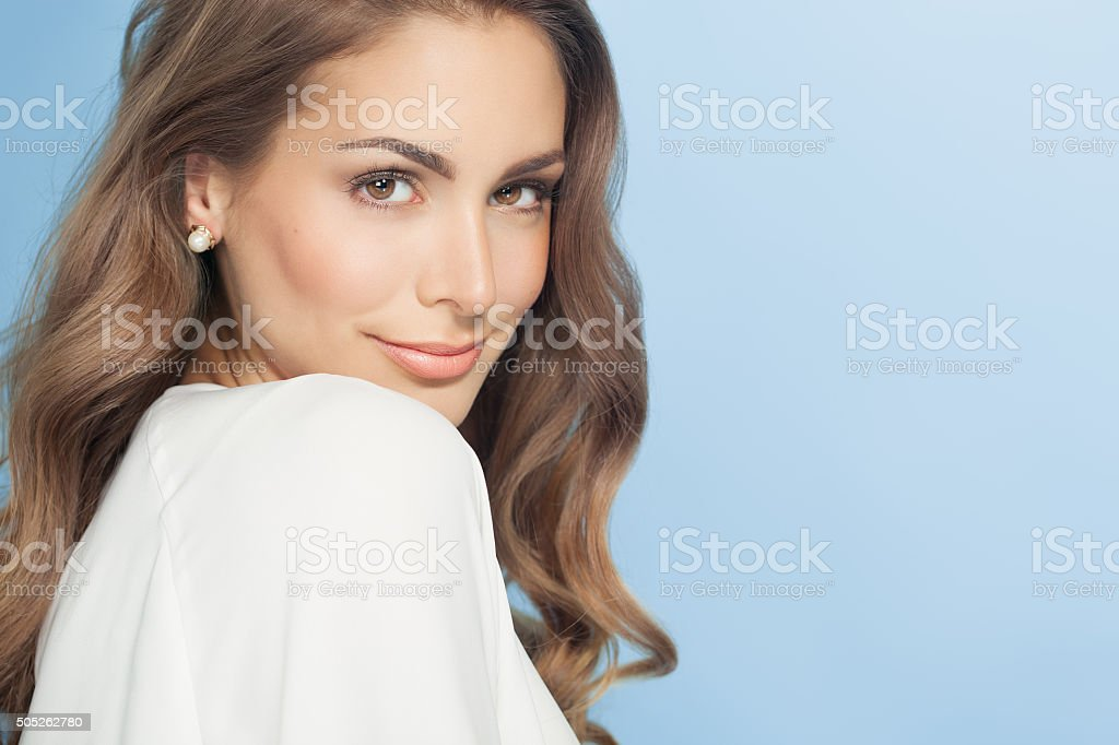 Young Woman Over Blue stock photo