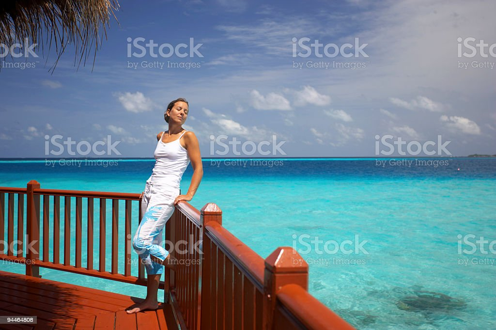 young woman over water terrace royalty-free stock photo