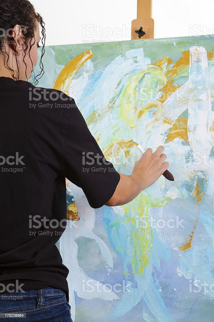 Young Woman Painting An Abstract royalty-free stock photo