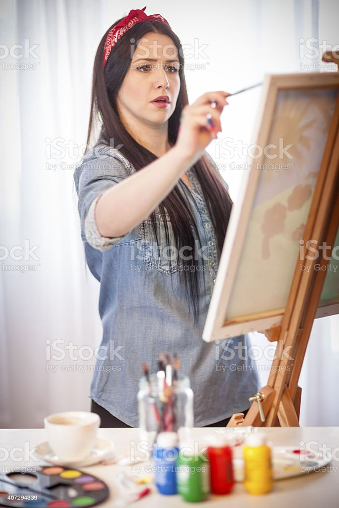 Young woman painting stock photo
