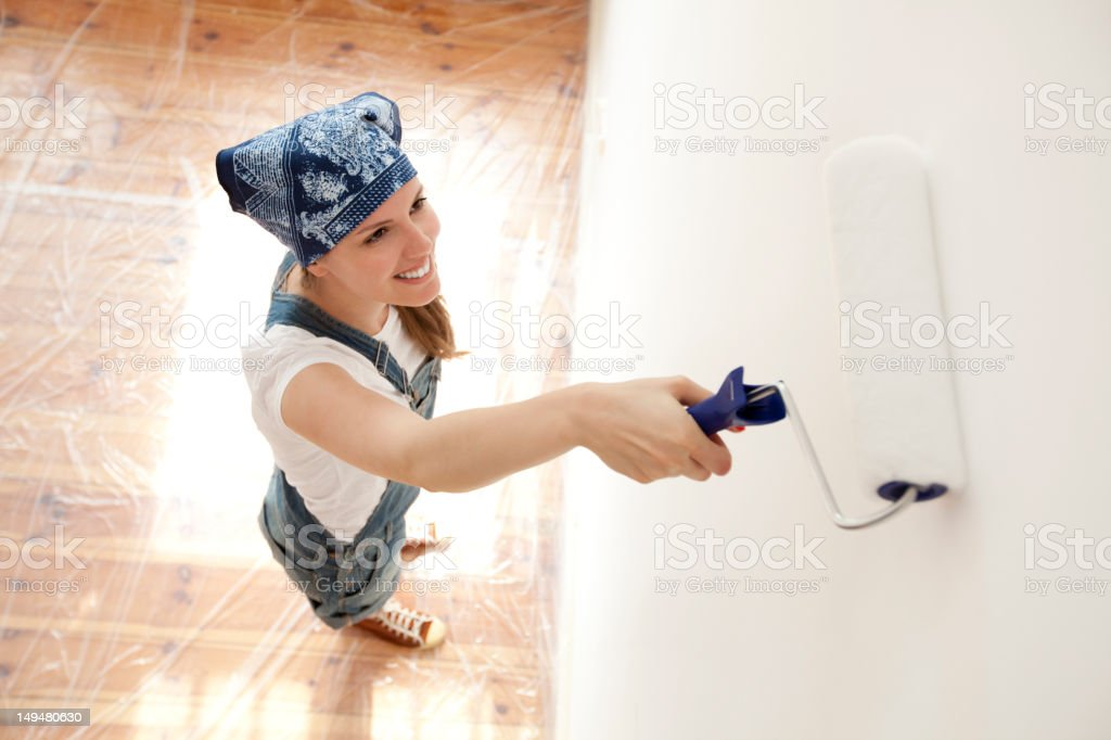 Young woman painting her house royalty-free stock photo