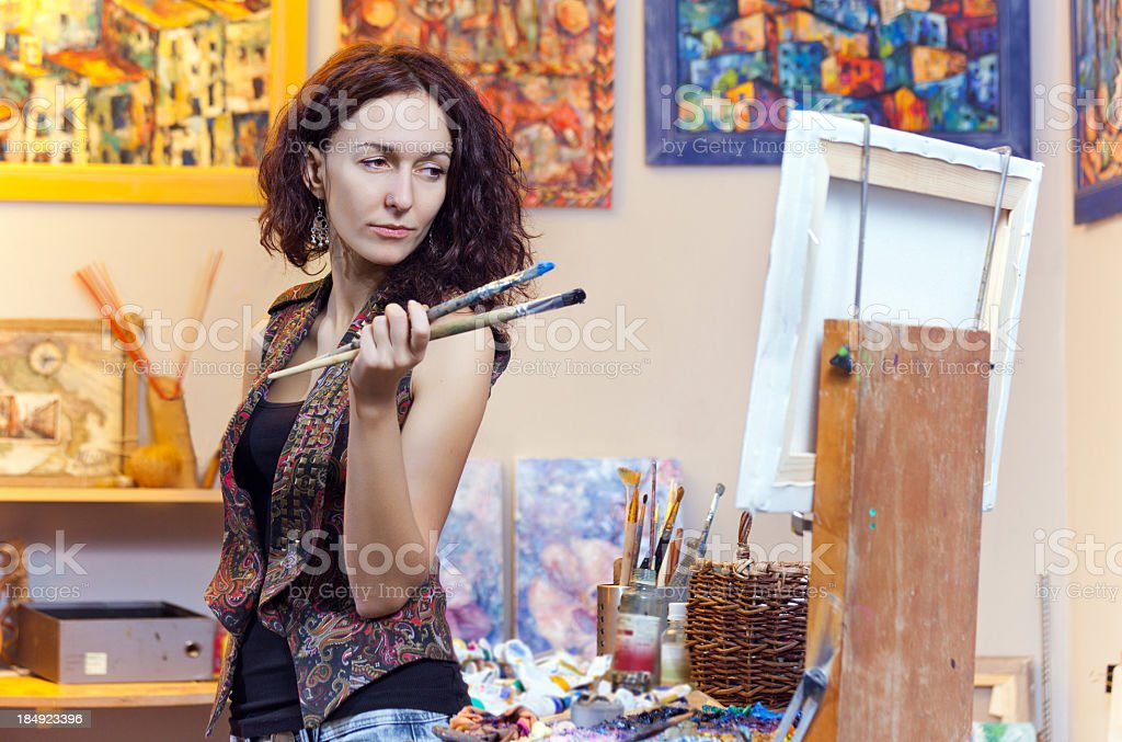 Young woman painting in his studio stock photo