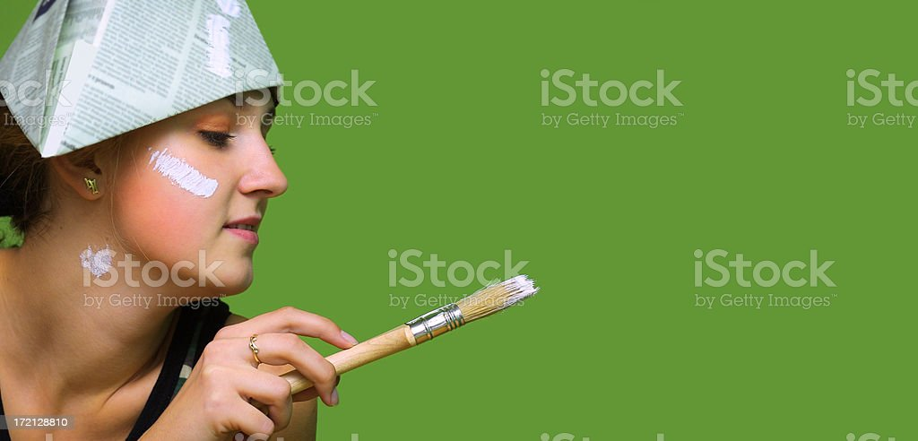 Young woman painting wall royalty-free stock photo