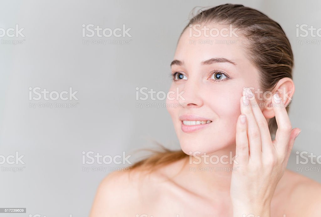 Young woman pampering her skin stock photo