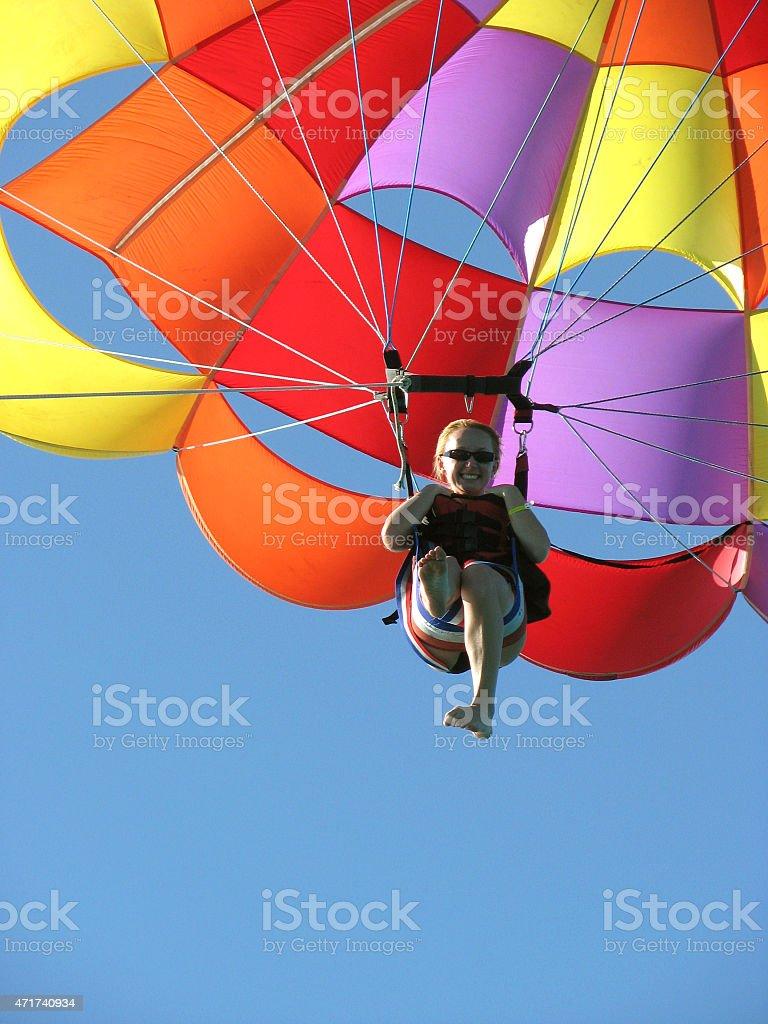 Young woman parasailing in Nassau, Bahamas. stock photo