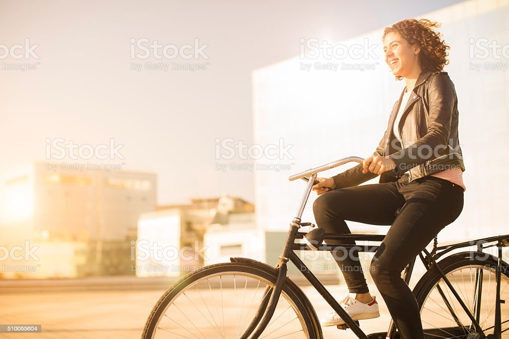 Young woman parking her bicycle in Barcelona. stock photo