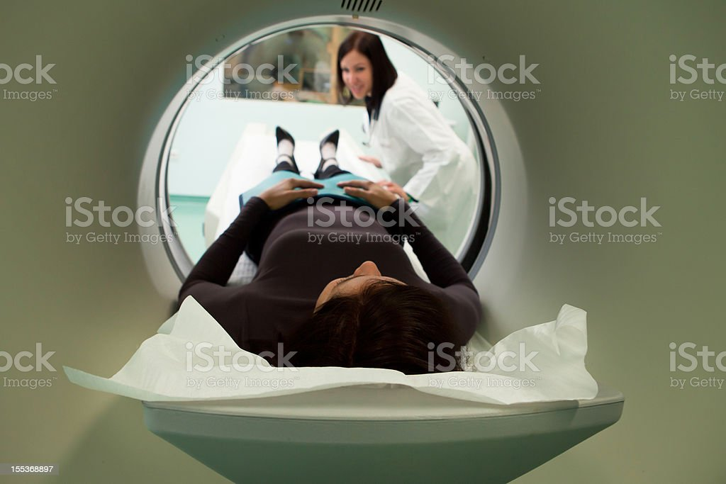 Young woman patinet waiting for CAT scan royalty-free stock photo